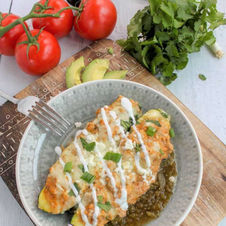 The best keto chicken enchiladas made with zucchini! This low carb chicken recipe with zucchini is extra cheesy, and loaded with flavor from the green enchilada sauce! This is the perfect healthy dinner recipe that you're family will love. Try this easy zucchini recipe for dinner tonight! #keto #ketorecipe #lchf #lowcarb #mexicanrecipes #zucchini #chicken #glutenfree #seekinggoodeats