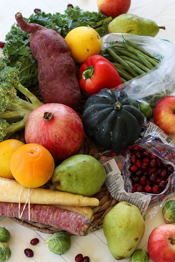 Closeup image of my Farmbox weekly content - vegetables and fruit. Carrots, brussel sprouts, yam, broccoli, pepper, green beans, kale, apples, pears, oranges, acorn squash, cranberries, and pomegranate.