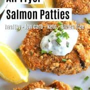 Pinterest pin with 3 air fryer salmon patties served on a white platter with a side of lemon wedges