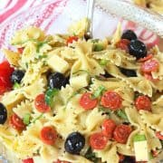 pinterest pin with a clear glass bowl full of italian pasta salad.