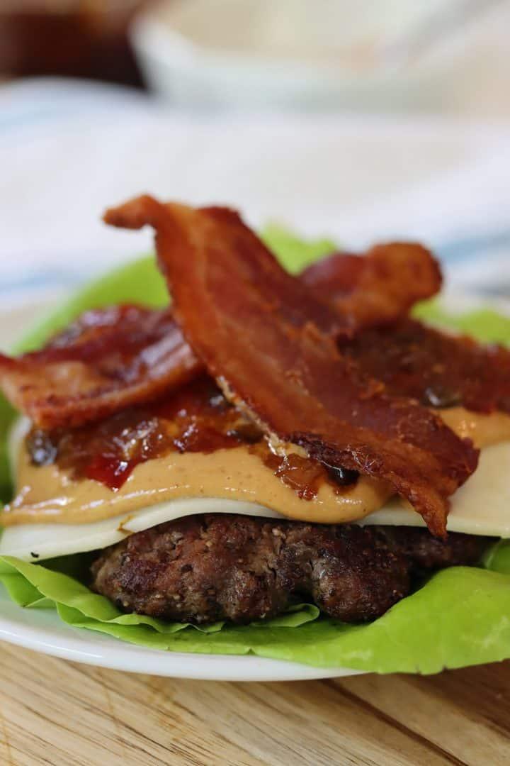 peanut butter burger served on lettuce instead of a bun
