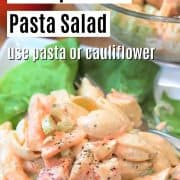 Pinterest pin with pasta salad served on a bed of lettuce with a full bowl in the background