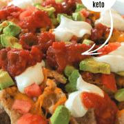 Pinterest pin with a closeup view of nachos served on a white dish and loaded with toppings.
