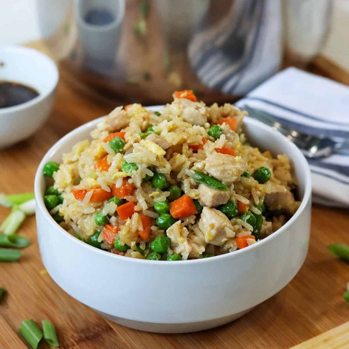 chicken fried rice served in a white bowl.