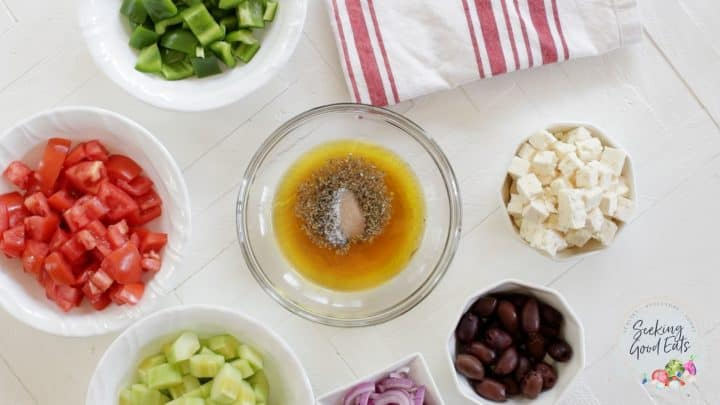 greek salad dressing ingredients in a small glass bowl