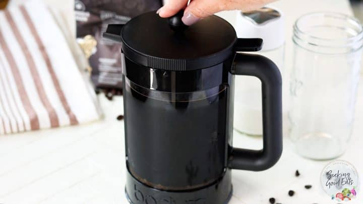 Using a french press to filter cold brew coffee grinds