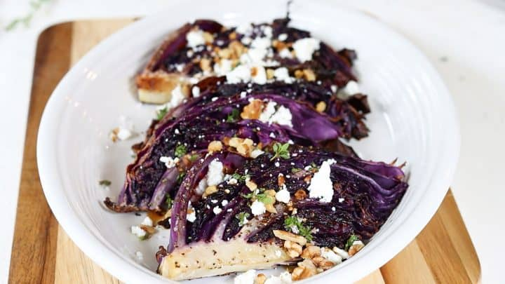 Adding the goat cheese, walnuts, and balsamic vinegar to roasted red cabbage