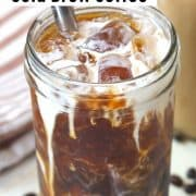 Pinterest pin with an image of cold brew coffee served over ice with a splash of cream