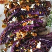 pinterest pin with roasted red cabbage on a white plate