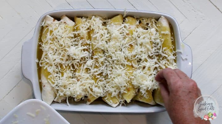 Assembling the casserole and sprinkling cheese on top
