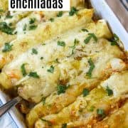 pinterest pin with green enchiladas with chicken in a white rectangle casserole dish